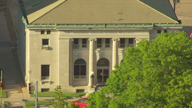 MS AERIAL ZO View of Masonic Building behind tree / Topeka, Kansas, United States