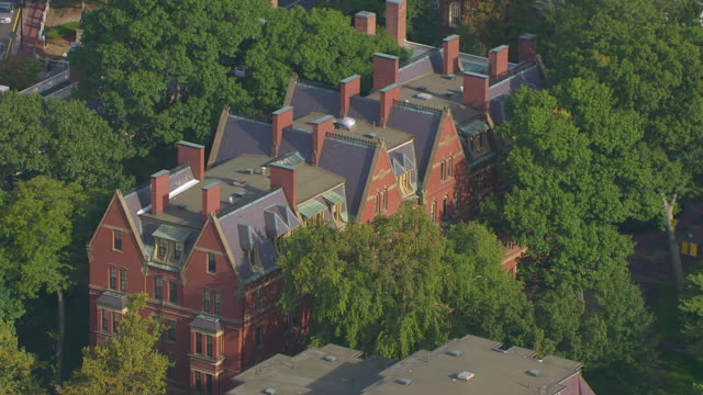 stockvideo's en b-roll-footage met ws aerial pov view of matthews hall with harvard yard on the harvard university campus / cambridge, massachusetts, united states - harvard university