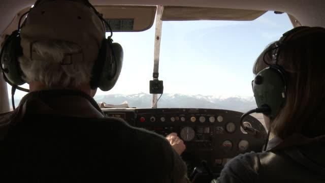 CU POV View of Mature pilot taxiing small aircraft before takeoff / Missoula, Montana, USA