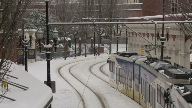 view of max light rail in portland usa - portland oregon snow stock videos & royalty-free footage