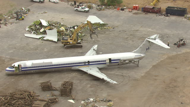 ws aerial view of md80 commercial jet airliner with rubble / roswell, new mexico, united states - roswell stock videos & royalty-free footage