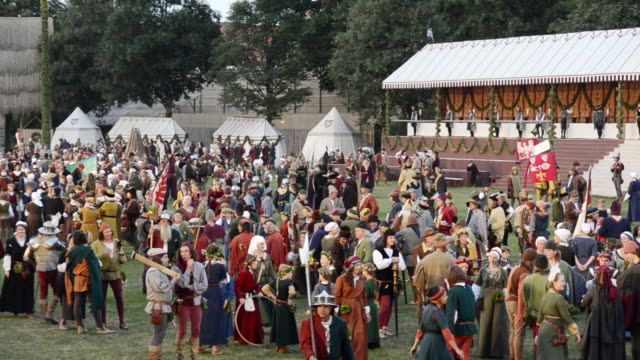 ws view of medieval party showing marriage of 1475 with medieval clothing at night camp, landshuter hochzeit 1475 / landshut, bavaria, germany - historische kleidung traditionelle kleidung stock-videos und b-roll-filmmaterial