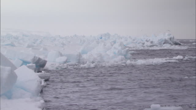 view of melting glacier in the north pole - crushed ice stock videos & royalty-free footage