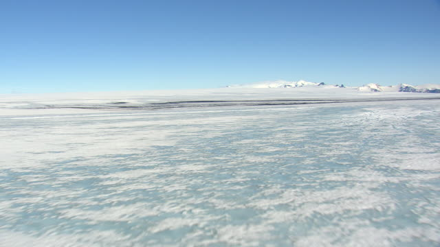 ws aerial zi view of melting ice sheet and snowy landscape / iceland - ice sheet stock videos and b-roll footage