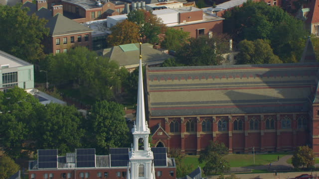 WS ZO AERIAL POV View of Memorial Church steeple and Widener Library in Harvard Yard / Cambridge, Massachusetts, United States