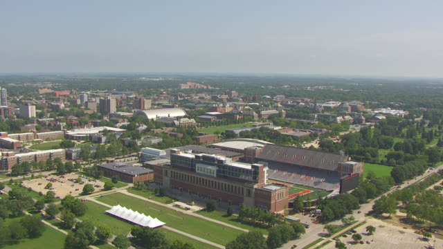 ws aerial pov view of memorial stadium with city / champaign, illinois, united states - illinois stock videos & royalty-free footage