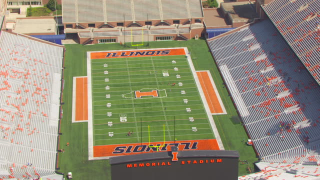 ws aerial pov view of memorial stadium with football pitch / champaign, illinois, united states - illinois stock videos & royalty-free footage