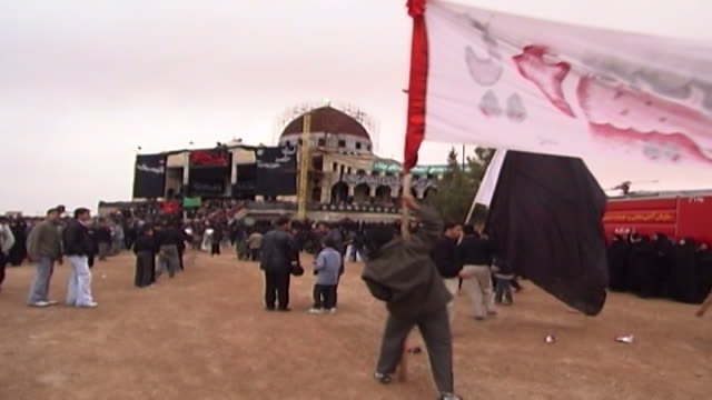view of men carrying banners at an ashura commemoration ashura the tenth day of the islamic month of muharram commemorates the death of hussain ibn... - ashura muharram stock videos & royalty-free footage