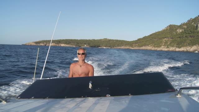 ts cu view of men driving in power speedboat / palma de majorque, majorque, spain - motoscafo da competizione video stock e b–roll