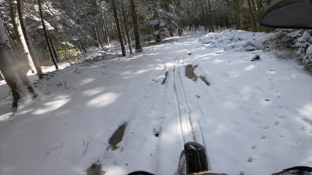 pov view of men racing motocross motorcycles on a dirt off road on snow in the winter. - cold temperature stock videos & royalty-free footage