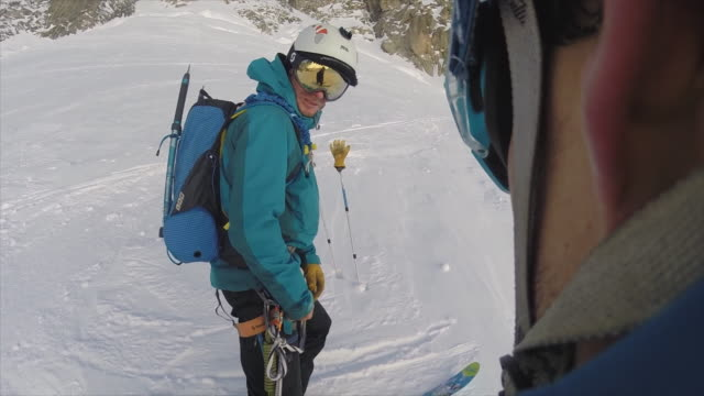 pov view of men skiing in the mountains. - winter sport stock videos & royalty-free footage
