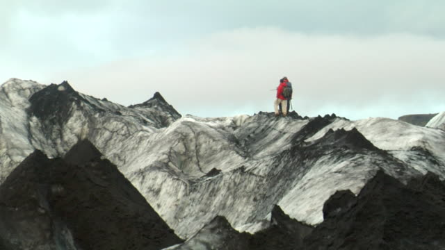 ms view of men standing on mountain / vestmannaeyjar, sudhurland, iceland - wiese stock videos & royalty-free footage