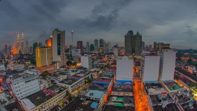 WS T/L View of Menara KL and Petronas twin towers / Kuala Lumpur, Malaysia