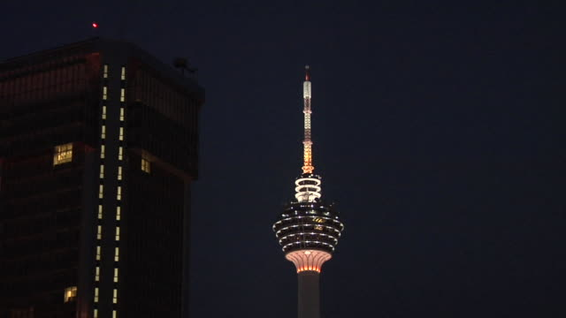 ws zo view of menara kuala lumpur tower with city / kuala lumpur, malaysia - menara kuala lumpur tower stock videos and b-roll footage
