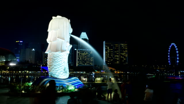 view of merlion fountain statue at marina bay - merlion fictional character stock videos and b-roll footage