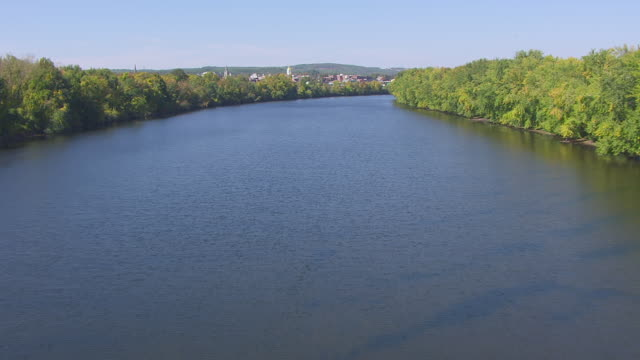 ws aerial pov view of merrimack river, town in background / concord, new hampshire, united states - new hampshire stock-videos und b-roll-filmmaterial