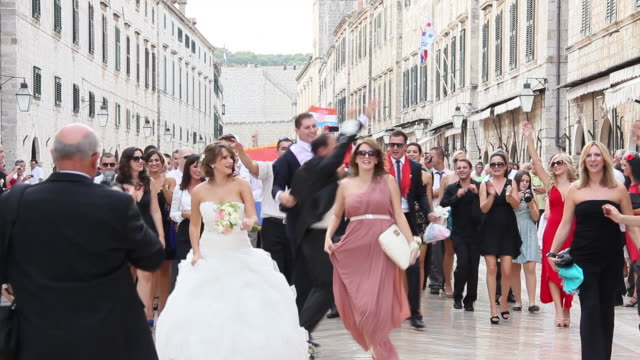 MS View of Merry wedding congregation moving through streets of Dubrovnik  / Dubrovnik, Dubrovnik-Neretva, Croatia