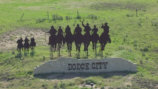 ws aerial zo view of metal sign with people riding horses / dodge city, kansas, united states - cowboy stock videos & royalty-free footage
