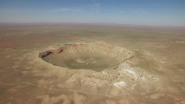 ws aerial pov view of meteor crater / winslow, arizona, united states - meteor stock videos & royalty-free footage