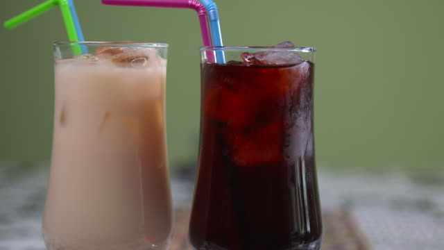 view of mexican traditional drinks (horchata and agua de jamaica) - saft stock-videos und b-roll-filmmaterial