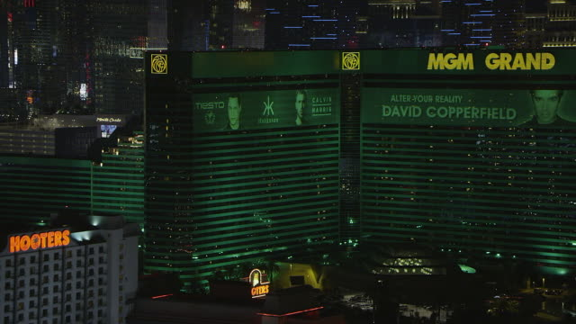 ws aerial view of mgm with city / las vegas, nevada, united states - mgm grand las vegas stock videos & royalty-free footage