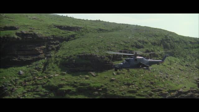 ws pov ts view of mi-24 assault helicopter flying through canyon - canyon stock videos & royalty-free footage
