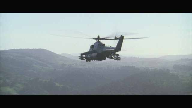 ws pov aerial view of mi-24 assault helicopter flying through canyon - helicopter stock videos and b-roll footage