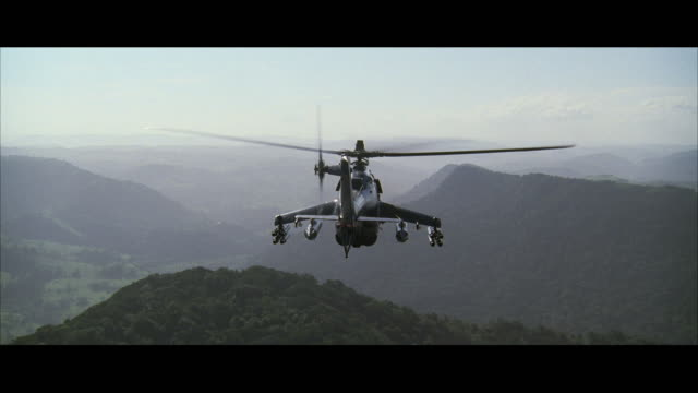 ws pov aerial view of mi-24 assault helicopter flying through canyon - military helicopter stock videos & royalty-free footage