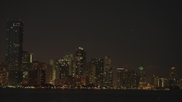 ws view of miami apartments at night with palm trees / miami, florida, united states - 2k resolution stock videos and b-roll footage