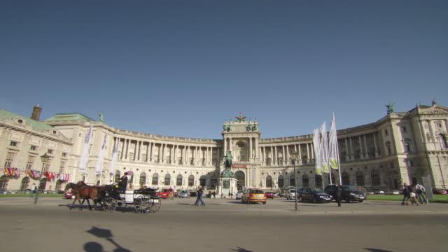WS View of Michaelerplatz with moving people / Vienna, Austria