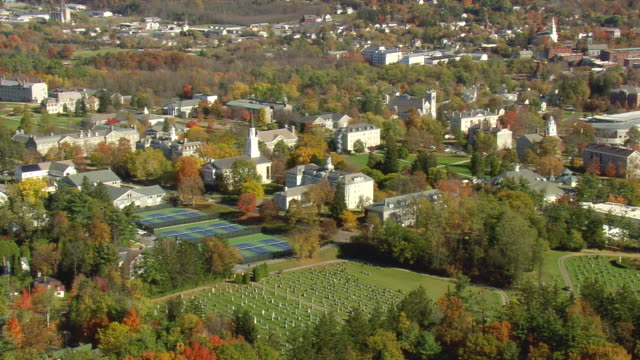 ms aerial zi zo pan view of middlebury college and hockey ground in city / vermont, united states - vermont stock-videos und b-roll-filmmaterial