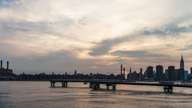 t/l ws view of midtown manhattan at sunset, nyc - long island video stock e b–roll