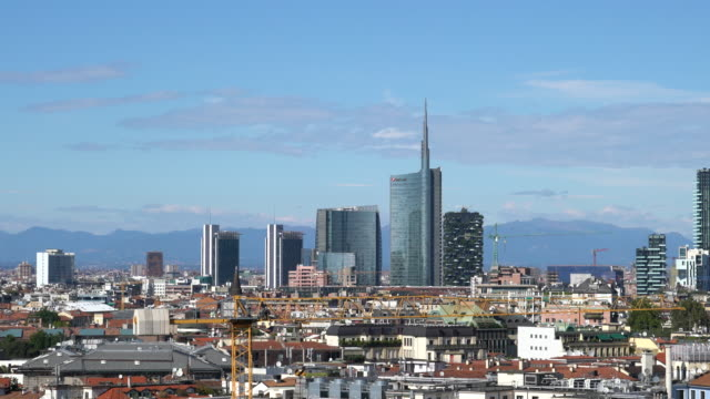 view of milan from the roof of the milan's cathedral - milano video stock e b–roll
