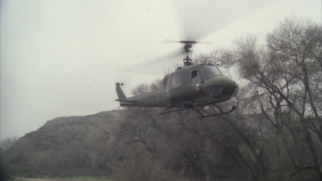 ws zo view of military helicopter taking off and landing - military helicopter stock videos and b-roll footage