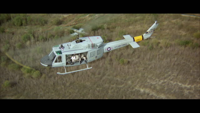 ws pov view of military helicopters above wilderness area - wilderness area stock videos & royalty-free footage