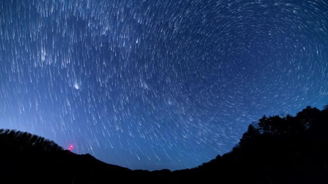 view of milk-way and star trail at winter night in injegun - 朝鮮半島点の映像素材/bロール