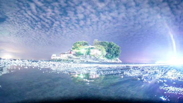 view of milky way over ganworam hermitage (popular tourist destinations) in seosan, chungcheongnam-do at night - 宇宙・天文点の映像素材/bロール