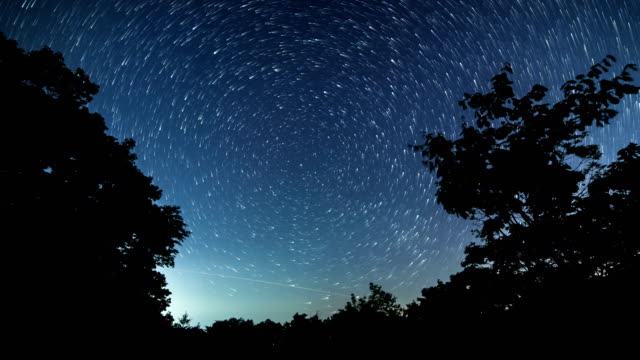 view of milkyway and star trail over hambaeksan mountain - weltraum und astronomie stock-videos und b-roll-filmmaterial