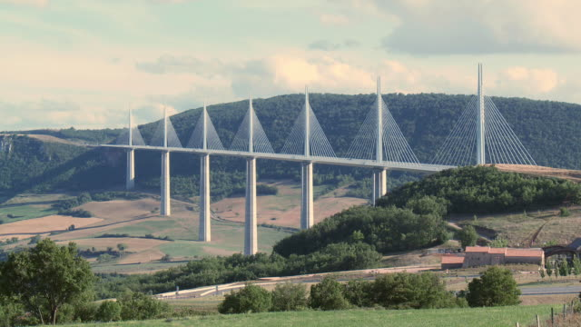ms view of millau viaduct spaning tarn valley / millau, aveyron, france - suspension bridge stock videos & royalty-free footage