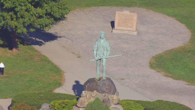 ws aerial pov view of minuteman statue / lexington, massachusetts, united states - minuteman statue lexington stock videos & royalty-free footage