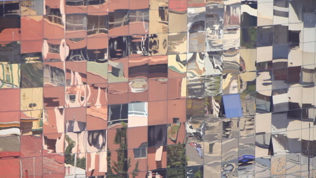 ms view of mirrored building facade with reflection of street movement / valparaiso, valle central, chile - distorted stock videos & royalty-free footage