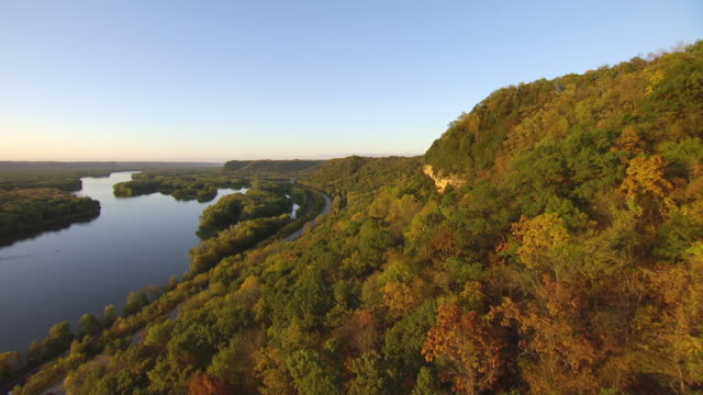 WS AERIAL View of Mississippi River along side of hill with rock surface exposed / Wisconsin, United States