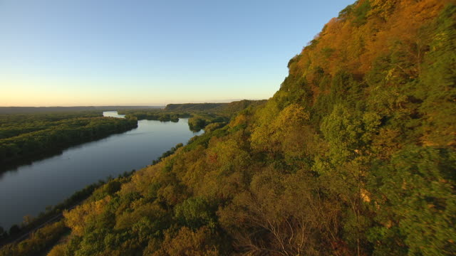 WS TU AERIAL POV View of Mississippi River, hill covered with trees / Wisconsin, United States