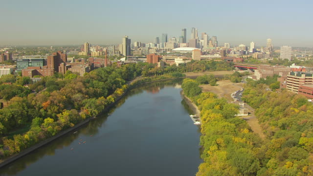 WS AERIAL View of Mississippi River towards downtown / Minneapolis, Minnesota, United States