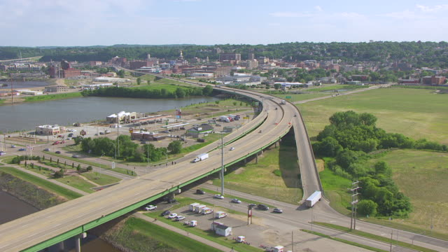 WS AERIAL POV View of Mississippi river with land vehicles moving on bridge / Dubuque, Iowa, United States
