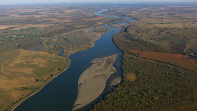 WS AERIAL POV View of Missouri and Knife River passing through farmland / Stanton, North Dakota, United States