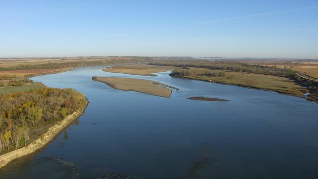 WS AERIAL POV View of Missouri River passing through farmland / North Dakota, United States