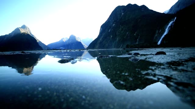 view of mitre peak and mountains in fiordland national park - low tide stock videos & royalty-free footage