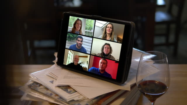 view of mobile device on video call with friends and coworkers - connection in process stock-videos und b-roll-filmmaterial