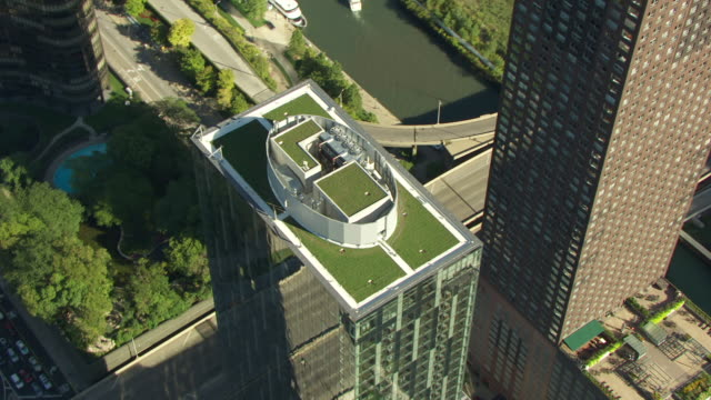 ms aerial pov zi view of modern building / chicago, cook county, illinois, united states - roof stock videos & royalty-free footage
